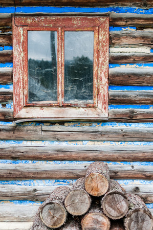 rustical: Vertical view of old rustical wooden hut with window.