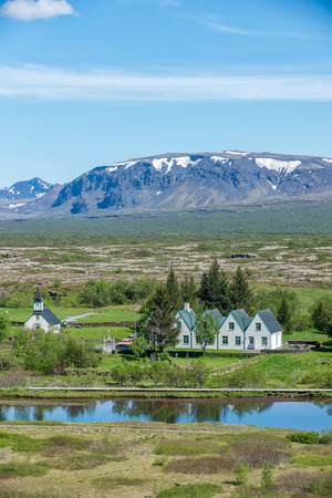 Scenic view of famous Thingvellir with white church, Iceland. photo