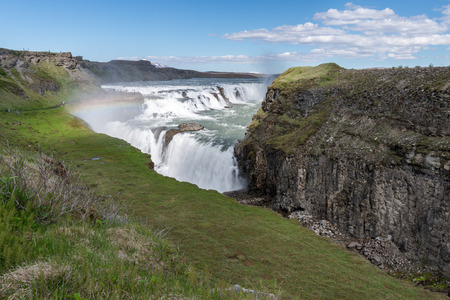 Gullfoss (Golden falls) waterfall and rainbow in Iceland. photo