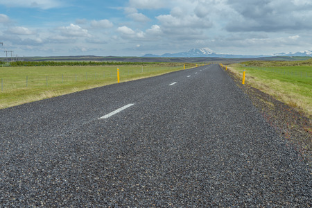 hekla: Typical road in Iceland with Hekla Vulcano on the horizon.