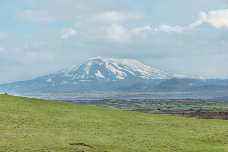 hekla: Scenic view of still active volcano Hekla covered with snow, South Iceland.