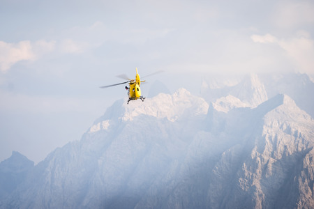 rescue helicopter: Medical rescue helicopter in air. Italian Dolomites.