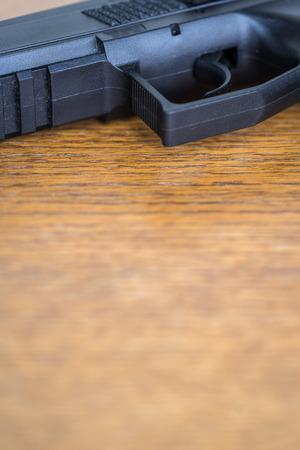 Close up view of handgun. Macro of pistol.