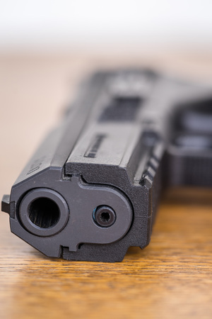 Detail view of front of pistol. Stock Photo
