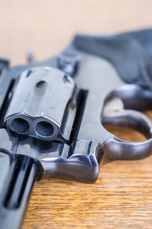 Close up view of handgun. Shallow depth of field. Macro shot of part of revolver.