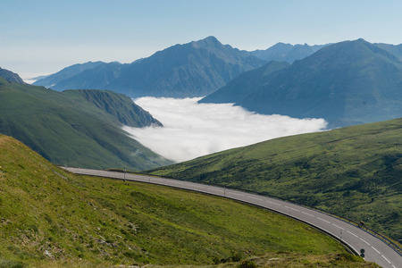 tourism in andorra: Scenic road leading through Pyrenees Mountains, France. Stock Photo