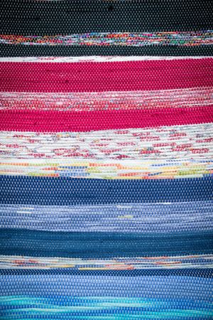 Detail of beautiful multi colored woven carpet.