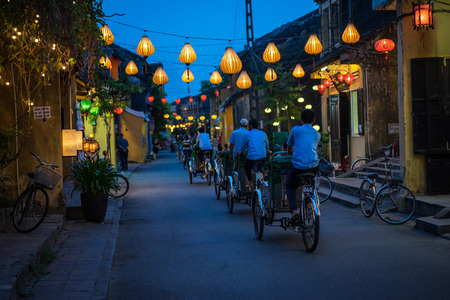 Night view of busy street in Hoi An, Vietnam. Hoi An is the Worlds Cultural heritage site, famous for mixed cultures and architecture. Editorial