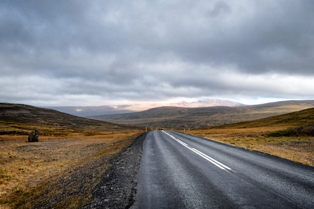Scenic view of remote road on Iceland surrounded by dramatic landscape.