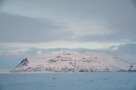 Dramatic icelandic landscape with snow covered mountains. Cold winter day in Iceland. Stock Photo