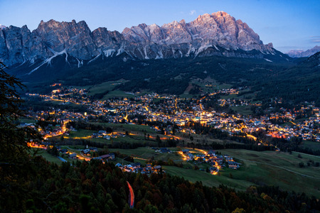 Late evening view of beautiful Cortina d'Ampezzo town, located in the heart of the Dolomites in an alpine valley, Italy. Stock Photo