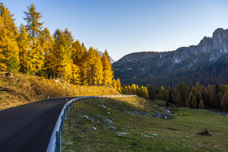 Colorful scenic view of majestic Dolomites mountains in Italian Alps. Landscape photo of colorful trees and rocky mountains in the the Italian Dolomites during autumn time.