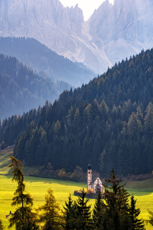 Wonderful Sunny Landscape of Dolomite Alps. St Johann Church, Santa Maddalena, Val Di Funes, Dolomites, Italy. Fairy velley in Dolomites mountains under sunlit. Amazing nature Background. Stockfoto