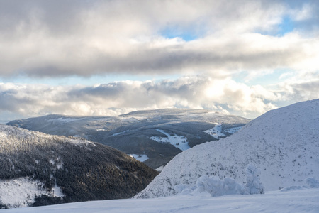 Winter snow covered mountain peaks in Krkonose National Park, Czech Republic, Europe.