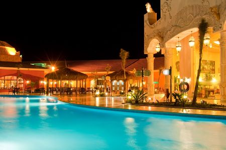 outdoor lighting: Hotel restaurant view. Night shot. Reflections in pool