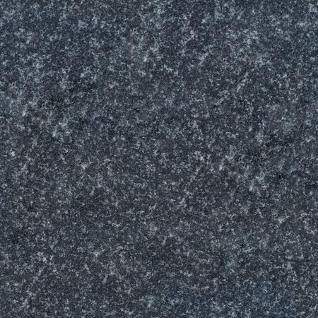 Seamless dark grey granite texture. Close-up photo
