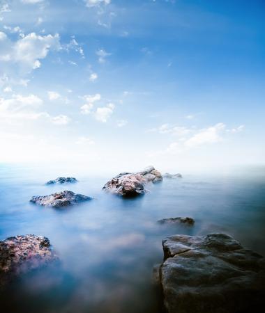 horison: Stones calm sea. Long exposure shot