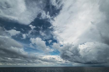 cielos abiertos: Dark clouds in open ocean. Tropical hurricane and sea storm Foto de archivo
