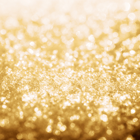 Gold shine lights frozen snow bokeh winter background