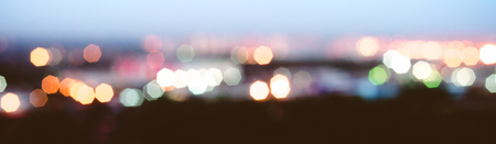City lights blur bokeh. Evening background