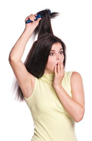 Girl with hairbrush photo