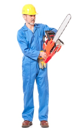 petrol powered: Worker with a chainsaw