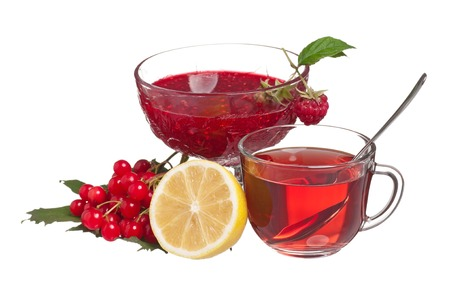 Glass cup with tea and raspberry jam on a white background photo