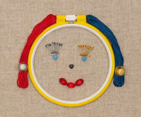 darn: Smiling face put from embroidery accessories over outline concept Stock Photo