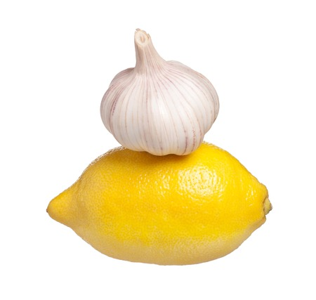 clean artery: Whole lemon and garlic isolated on white background cutout