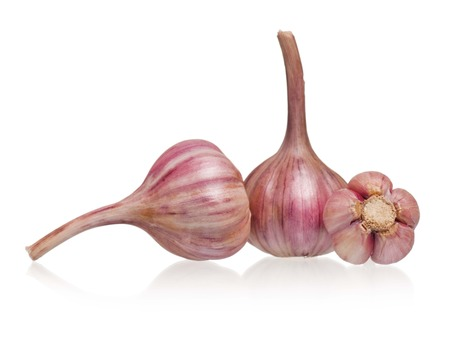 clean artery: Raw garlic with shadow over white background cutout Stock Photo