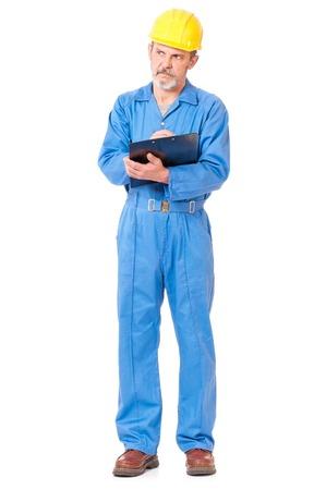 plane table: Trabajador adulto en un uniforme con plancheta sobre fondo blanco Foto de archivo