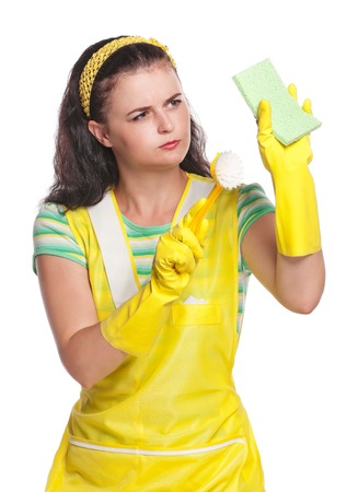 houseclean: Young housewife with sponge and brush isolated on white