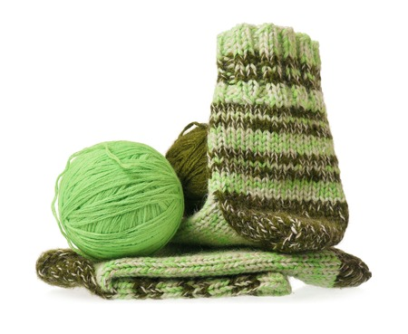 Knitted warm socks with yarn threads over white