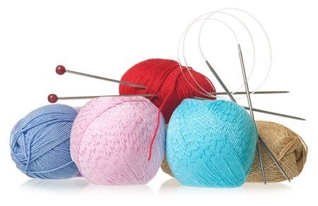Acrylic and yarn threads for knitting isolated on white  photo