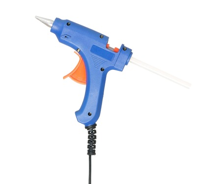 cohere: New blue glue gun isolated on white background cutout