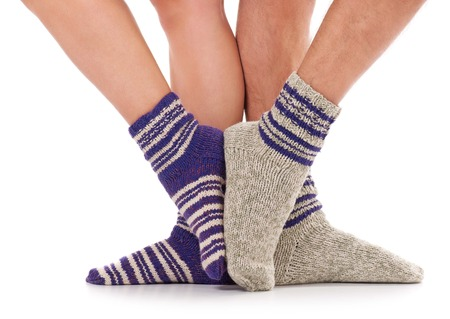 Pair of man and woman in the knitted socks over white background Stock Photo