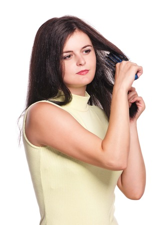 Young pretty woman with hairbrush isolated on white background Stock Photo - 24236166