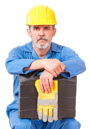 Tired adult worker has a rest sitting over white background photo