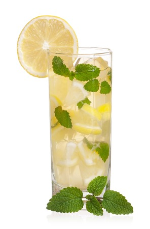 Glass of lemonade with lemon and mint isolated on white