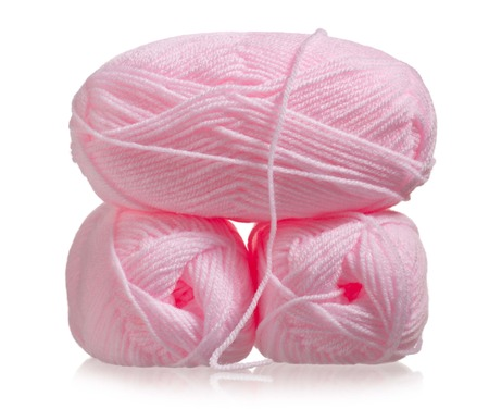 acrylic yarn: Pink acrylic yarn for knitting isolated on white  Stock Photo