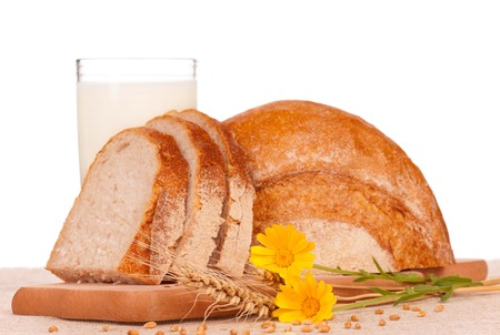 White bread slices with glass of milk over white background photo