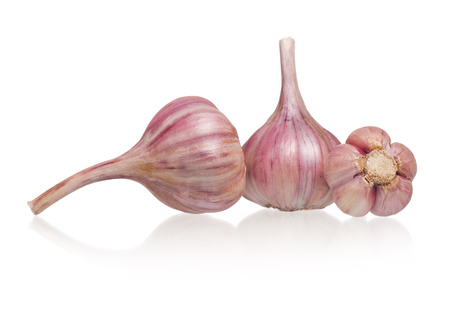 clean artery: Raw garlic bulbs isolated on white background cutout