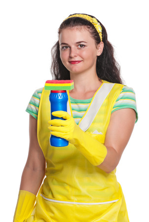Young housewife with cleaner and sponge isolated on white background photo