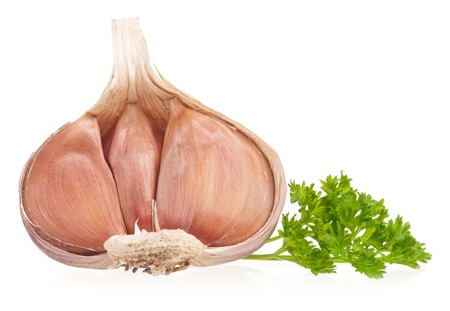 clean artery: Garlic bulb with fresh parsley on white cutout Stock Photo
