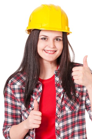 Portrait of a playful young woman in a protective helmet on white background photo