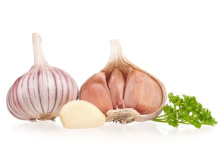 clean artery: Garlic bulbs with fresh parsley on white background cutout