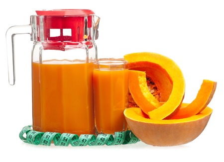 Fresh pumpkin juice with slices of raw pumpkin isolated on a white background photo