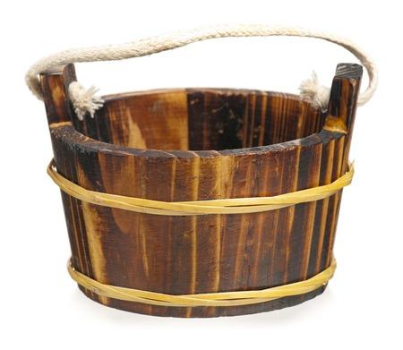 Empty decorative wooden tub isolated on white background photo