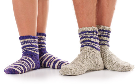 Pair of man and woman in the knitted socks over white background Reklamní fotografie