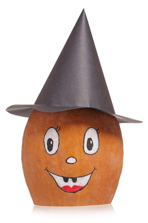 Funny Halloween gourd with black hat isolated  photo